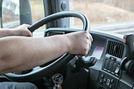 Inadequate pay and driver facing cameras putting people off truck driving